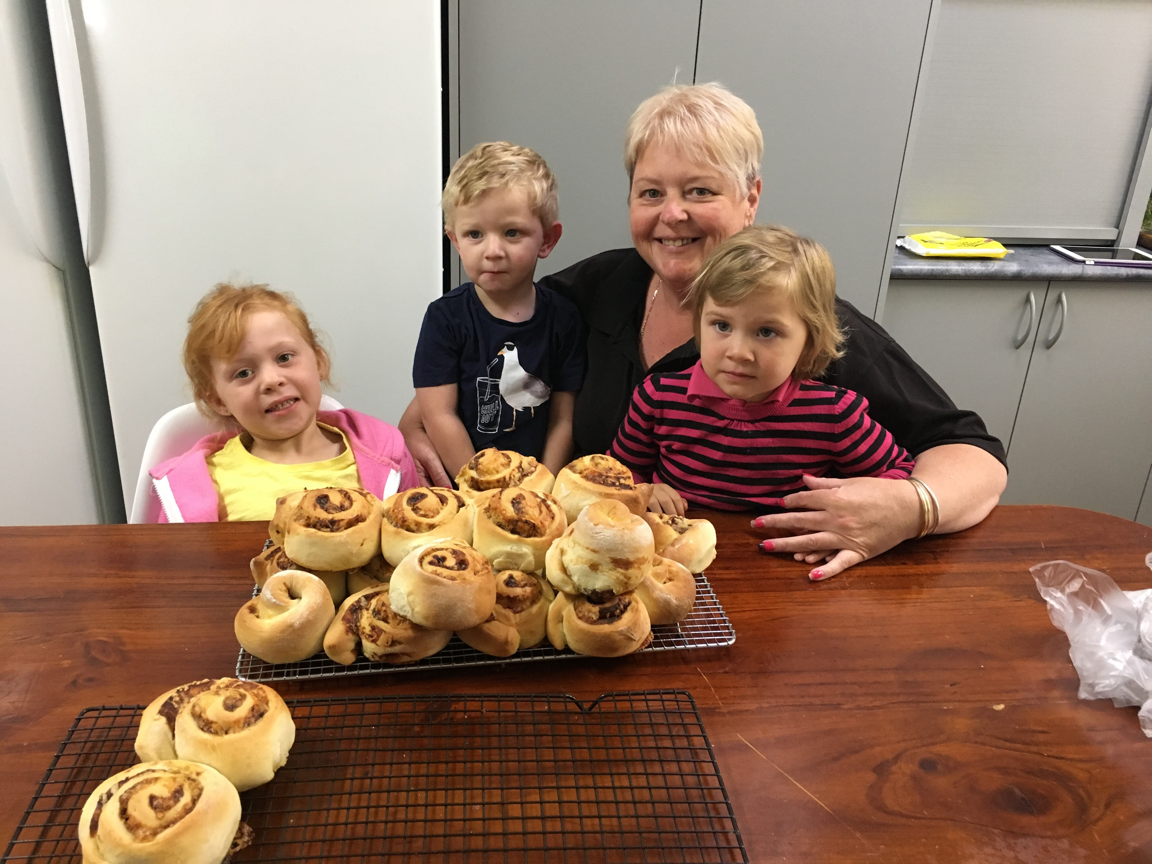Family Day Care Educator Tracey Jones with Savannah, Ashton and Indianna enjoying the rewards of their cooking experience