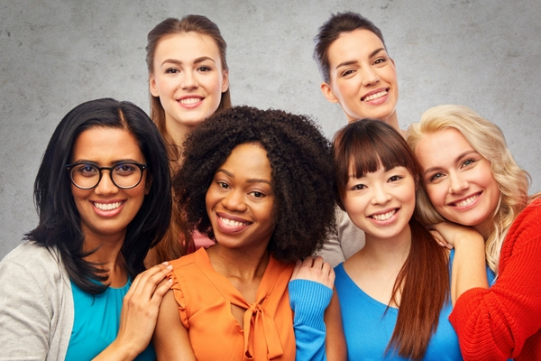 Six smiling women of different cultural backgrounds