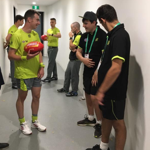 Jedd, AFL All Abilities Ball steward chatting with umpires before the game