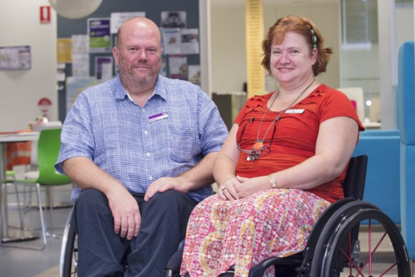 A man and a lady sitting in their wheelchairs