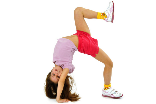 Young girl bending over backwards attempting to do a handstand