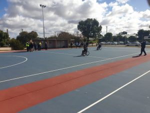 People playing on netball court
