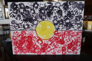 Aboriginal flag made out of paint hand prints