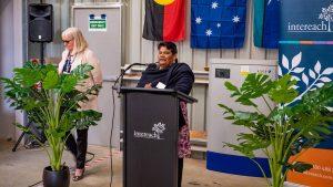 Woman speaking behind Intereach podium