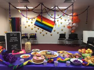 Table of party food and purple streamers