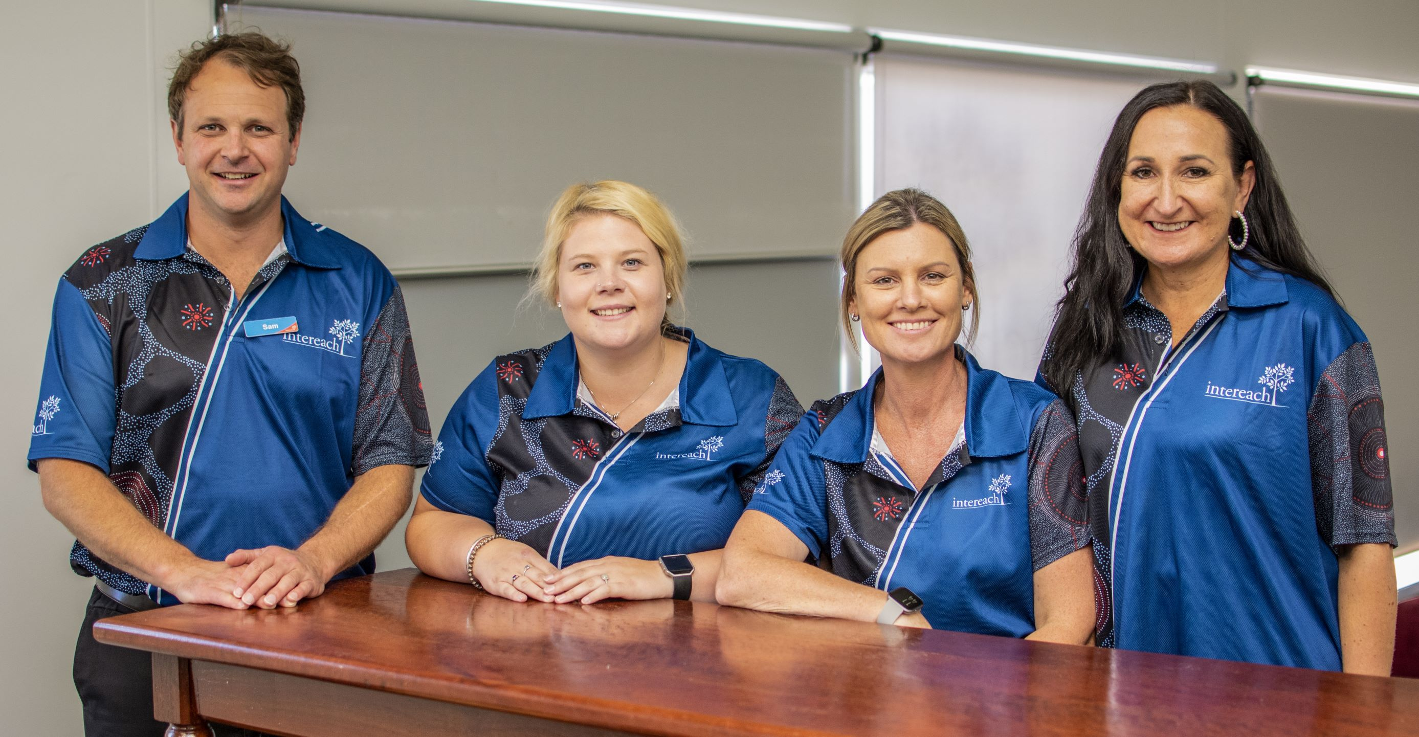 Intereach staff in new polo shirts